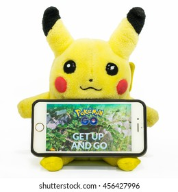BANGKOK - THAILAND - JULY 19, 2016: A shot of Pikachu plushie with the web page of 'Pokemon Go' app. The game has sent Nintendo and Nikkei stocks soaring since its first launch.