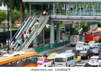 BANGKOK, THAILAND - July 19, 2017: Elevated pedestrian walkway (Skywalk) at Ratchadamri Road near Central World shopping mall.