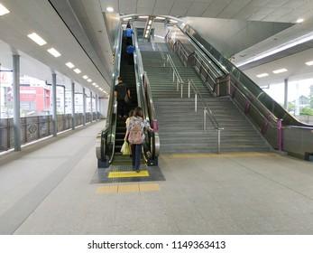 Bangkok, Thailand - July 19, 2018: Escalator stairs in MRT subway train station. Electric escalator take passengers up the MRT underground station in Bangkok capital city , Thailand