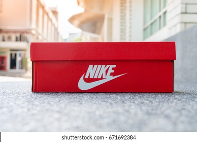 BANGKOK, THAILAND - JULY 2, 2017: Nike box shoes on cement floor,  Nike, Inc. is an American multinational corporation that designs, develops, manufactures and sells footwear and other items