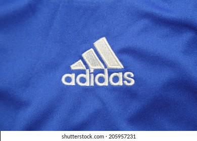 BANGKOK, THAILAND - JULY 20, 2014: the logo of Adidas brand  on the football  jersey  on 20 July 2014 in Bangkok Thailand.