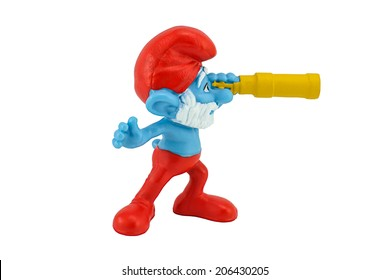 BANGKOK, THAILAND - July 20, 2014 : PAPA Smurfs hold a monocular  toy character from smurfs movie. There are toy sold as part of McDonald Happy Meal.