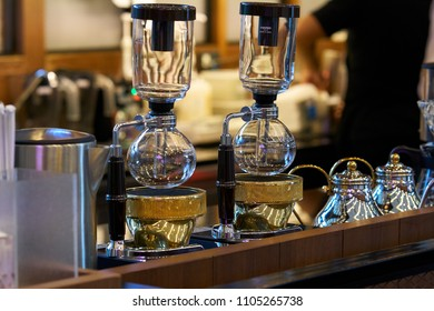 "BANGKOK, THAILAND - July 20, 2017:  Hario vacuum coffee maker syphon ""Technica"" TCA-3 on coffee shop counter."