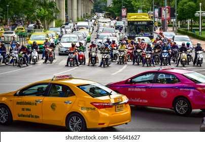 BANGKOK, THAILAND - JULY 2016: Taxis in front of many two-wheelers in the Thai capital