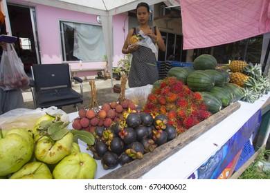 BANGKOK (THAILAND) - JULY 2017: Fruit street vendor in the Nonthaburi district in Bangkok. On the table there are mangosteen, rambutan, papaya etc.