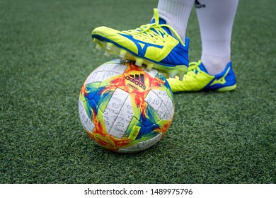 Bangkok / Thailand - July 2019 : A football player is ready to kick-off the ball in training session. He wears Mizuno Rebula 3 football boots which is designed for play maker player.