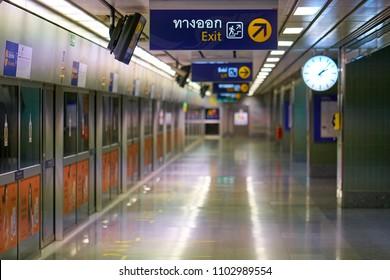 BANGKOK, THAILAND - July 21, 2017: Empty interior of Metropolitan Rapid Transit (MRT) train station with platform screen doors.