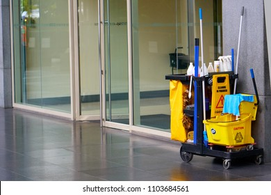 BANGKOK, THAILAND - July 21, 2017: Janitor cleaning cart standing near shopping mall entrance