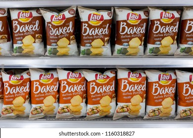 Bangkok, Thailand - July 21, 2018 : Rows of Lays brand of potato chips for sale on a shelf at Tesco Lotus Rama I hypermarket.