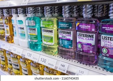 Bangkok, Thailand - July 21, 2018 : Rows of Listerine brand of mouth wash for sale on a shelf at Tesco Lotus Rama I hypermarket.