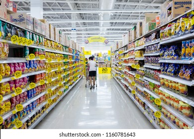 Bangkok, Thailand - July 21, 2018 : Shopping aisle with rows of assorted snacks for sale at Tesco Lotus Rama I hypermarket.