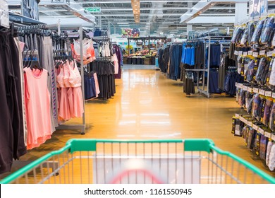 Bangkok, Thailand - July 21, 2018 : View from a shopping cart in front of a clothing section at Tesco Lotus Rama I hypermarket