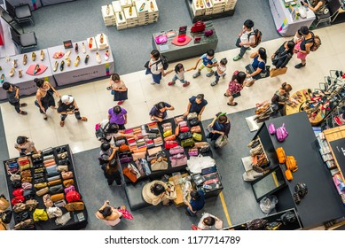 Bangkok, Thailand - July 21, 2018: People walk among stands of Terminal 21 Asok Shopping Mall, a top - down view.