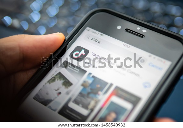 Bangkok, Thailand - July 21, 2019 : iPhone 7 showing its screen with TikTok application information on App Store.