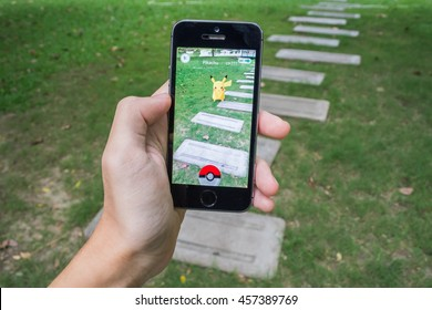 Bangkok, Thailand - July 22, 2016 : Pokemon Go is a new augmented reality game which lets you walk in the real world to catch the Pokemon.
