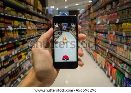 Bangkok, Thailand - July 22, 2016 : Charmander was found at a supermarket in Pokemon Go, a new augmented reality game which lets you walk in the real world to catch the Pokemon.