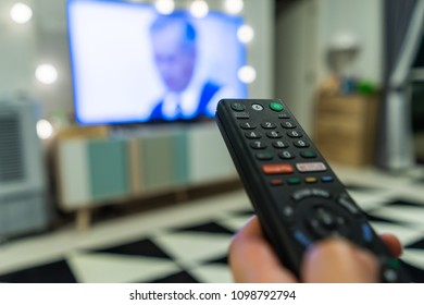 Bangkok, THAILAND July 22 2018:A Smart TV remote commander with Smart TV Assistant function like Google Voice, Google Play & Netflix on Blur TV background