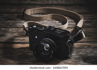 Bangkok Thailand - July 22, 2019: Leica MP-240 camera with Leica 35 F2 Summicron M Version 4 Lens on wooden table. The Leica MP-240 is a full-frame digital rangefinder camera of Leica Camera AG.