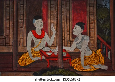 BANGKOK, THAILAND - July 23, 2018; Mural painting in Watpho, Bangkok, tells us about Ancient Thai's living especially for dining. the painting was painted of two person are dining in Thai style.