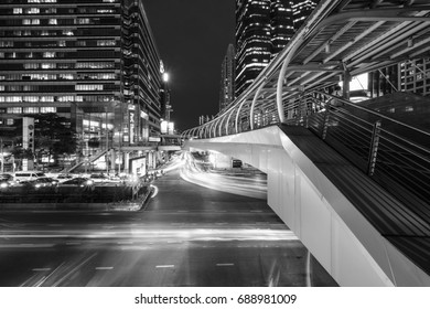 Bangkok, Thailand - July 25, 2017: Sky walker at the center connected to electric train station colorful in night bangkok city