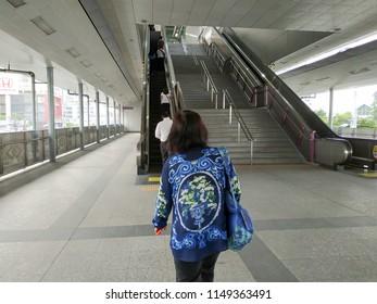 Bangkok, Thailand - July 25, 2018: Escalator stairs in MRT subway train station. Electric escalator take passengers up the MRT underground station in Bangkok capital city , Thailand