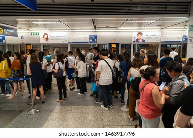 BANGKOK THAILAND - JULY 25, 2019: Crowded passengers in MRT subway train barriers in Bangkok Thailand