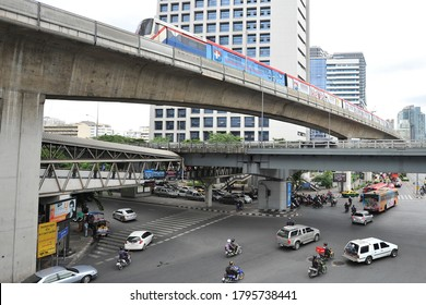 Bangkok, Thailand - July 26, 2013: Road vehicles and a BTS Sky Train make their way through streets in the city centre. The Thai capital was founded in 1782 and is now home to 8.3 million people.