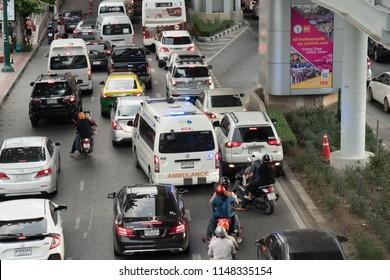 BANGKOK, THAILAND - JULY 26, 2018 :Ambulance Bangkok in traffic jam. Bangkok is famous for its heavy traffic in the city centre. at  BTS chatuchak station phahonyothin road chatuchak Bangkok, Thailand
