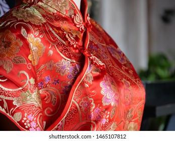 Bangkok, Thailand - July 26 2019: The red qipao or cheongsam or mandarin gown, Beautiful Chinese tradional feminine body-hugging dress