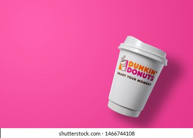 Bangkok ,Thailand - July 26 2019 : Dunkin donuts hot coffee cup on colourful background. Dunkin donuts is an American global doughnut company and coffee house chain.