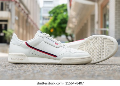BANGKOK, THAILAND - JULY 27, 2018 : Original Adidas Continental 80 Shoes , sneakers, shows the logo on street cement floor. Sport and casual footwear concept.