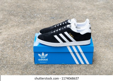 BANGKOK, THAILAND - JULY 27, 2018 : Original Adidas Gazelle running shoes, sneakers, trainers shows the logo with a brand box on street background. Sport and casual footwear concept.