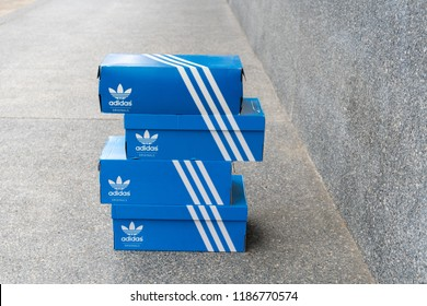 BANGKOK, THAILAND - JULY 27, 2018: Adidas Sign On Adidas Shoe Box. Founded in 1924 is a German multinational corporation that designs and manufactures sports shoes, clothing and accessories.