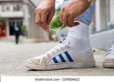 BANGKOK, THAILAND - JULY 27, 2018 : A Men are wearing old shoes  adidas Originals Nizza Low shoes. Originally conceived as basketball trainers, casual design made them a style hit on the streets
