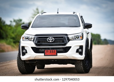 Bangkok Thailand - July 27 2018 : New Toyota Hilux Revo Rocco white Pickup  Truck Offroad Car double cab 4x4 On a dirt road car brand from Japan based