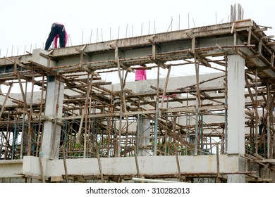 Bangkok, Thailand - July 27:Workers work on a Condominium construction site.They are workwear making reinforcement metal framework for concrete pouring,Thailand on August 27, 2015.
