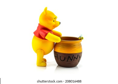 BANGKOK, THAILAND - July 28, 2014 : Figure of Winnie the Pooh and hunny pot. Winine the Pooh is animation from Disney.