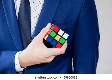 BANGKOK, THAILAND - JULY 28, 2016: Businessman holding Rubik's cube - business solving problem and brain training concept.
