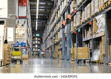 Bangkok, Thailand - July 28, 2019 : It is a warehouse of a large-scale shopping center, Rows of shelves with boxes, Blurred business background.