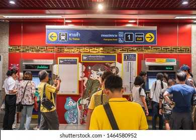 "Bangkok, Thailand July 29, 2019. Bangkok residents at soft opening of Metropolitan Rapid Transit or MRT station ""Wat Mangkon"" locate in the middle of Chinatown. Station signage show different exits."