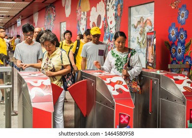 "Bangkok, Thailand July 29, 2019. Bangkok residents going through ticket machine at soft opening of Metropolitan Rapid Transit or MRT station ""Wat Mangkon"" located​ in the middle of Chinatown."