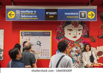 "Bangkok, Thailand July 29, 2019. Bangkok residents at soft opening of Metropolitan Rapid Transit or MRT station ""Wat Mangkon"" locate in the middle of Chinatown. Signage showing different exits."