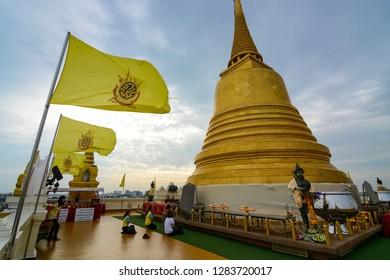 Bangkok, Thailand - July 3, 2016: Locals pray before the Gold chedi atop the Golden Mount at Wat Saket