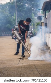 Bangkok, Thailand - July 3, 2016 : Unidentified people fogging DDT spray for mosquito kill and protect by control mosquito is a carrier of Malaria, Encephalitis, Dengue and Zika virus in village.