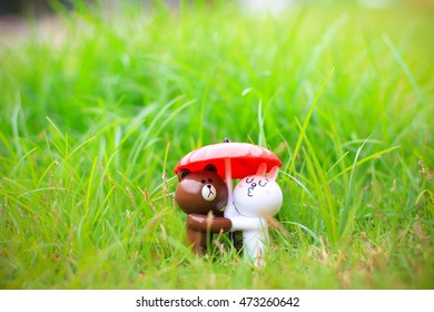 Bangkok, Thailand - July 30 2016, Sweet Brown & Cony Figure under the umbrella with green grass : Brown & Cony are popular Line's Character