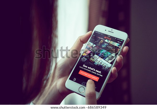 Bangkok, Thailand - July 30, 2017 : Netflix app on smart phone screen. Netflix is an international leading subscription service for watching TV episodes and movies.