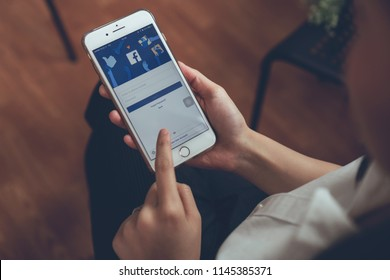 Bangkok, Thailand - July 30, 2018 : hand is pressing the Facebook screen on apple iphone6 ,Social media are using for information sharing and networking.
