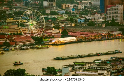 Bangkok, Thailand - July 30 2018 :  Asiatique The Riverfront night shopping mall at sunset.