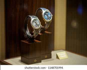 BANGKOK, THAILAND - July 30, 2018: Close-up detail multiple Patek Philippe perpetual calendar platinum watches on wooden display stands at Siam Paragon boutique. Luxury and horlology.