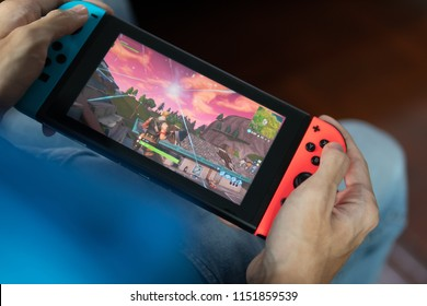 Bangkok, Thailand - July 30, 2018 : Nintendo Switch showing its screen with Fortnite game.